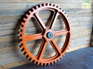 Aged orange gear | vintage industrial